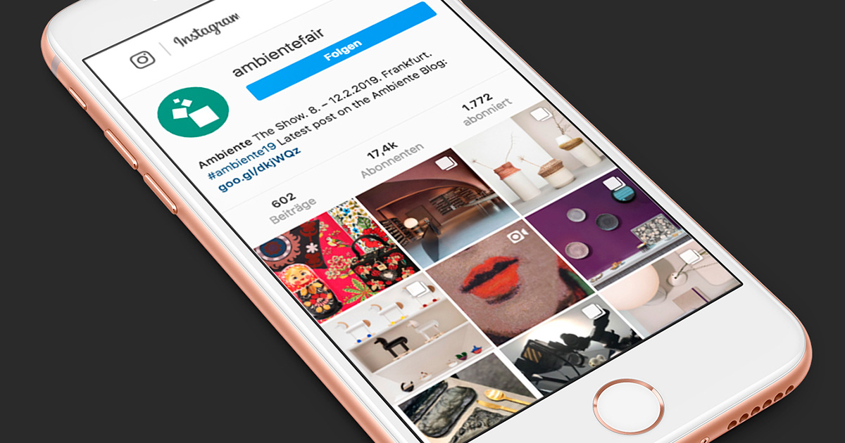 A smartphone shows the instagram account of the ambientefair